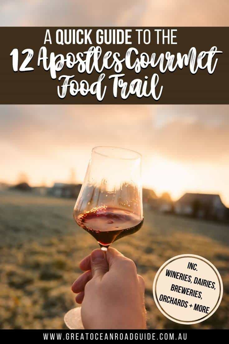 12 Apostles Gourmet Food Trail Pin Image of a woman holding a glass of red wine up to the sunset in a field