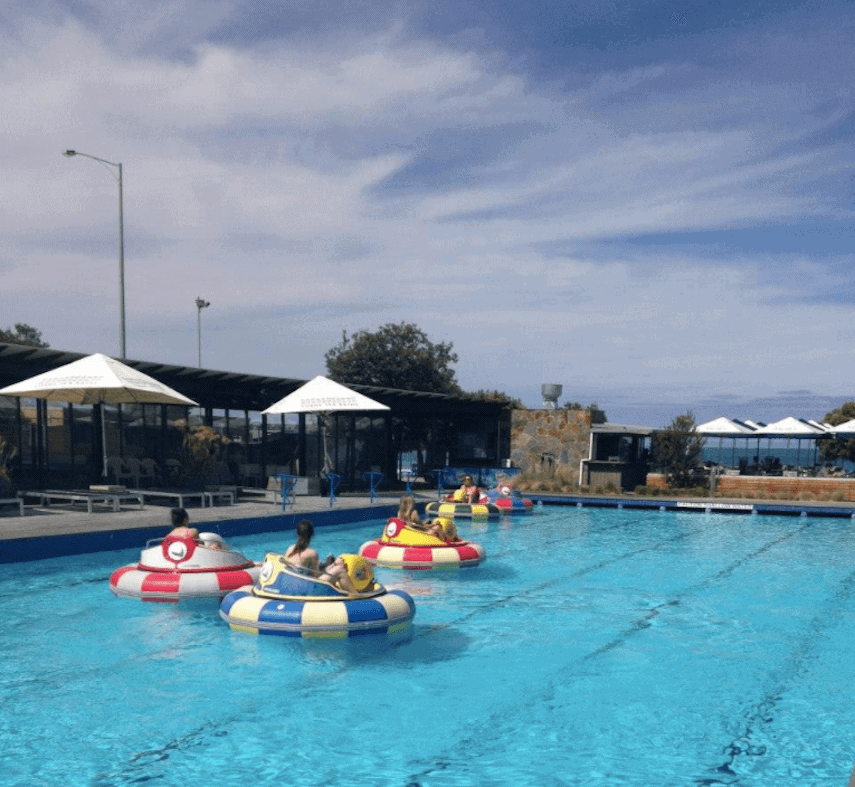 Swimming pool with three bumper boats at Lorne Sea Baths