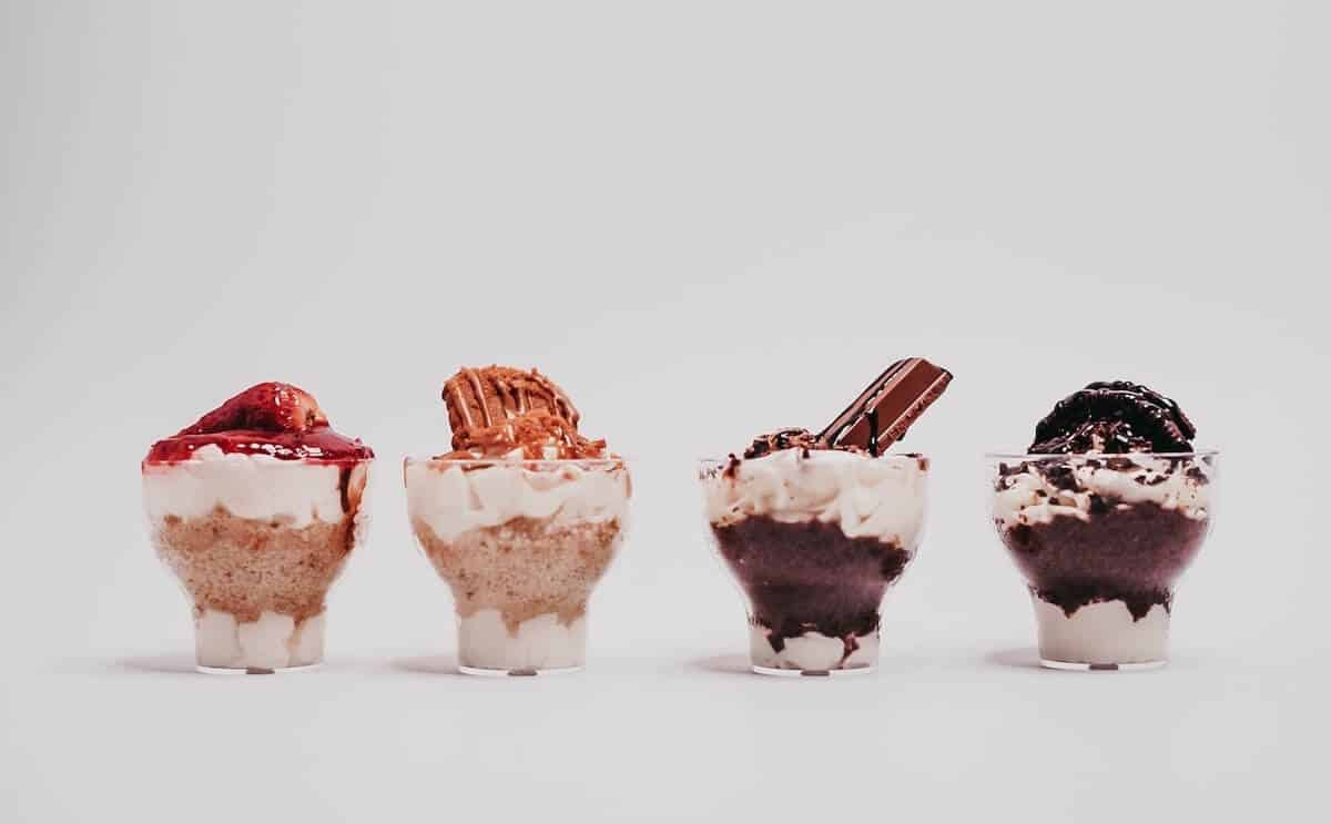 Quick Guide to the 12 Apostles Gourmet Food Trail header image of 4 mini desserts set out in a row in front of a white background