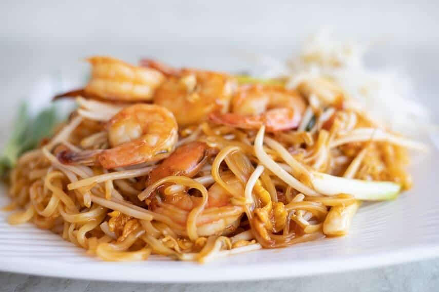 Plate of Thai noodles with prawns and bean shoots