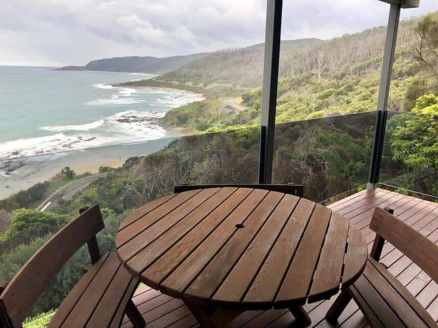 Balcony with round wooden table and chairs of Wye Escape Holiday Home Wye River overlooking the ocean