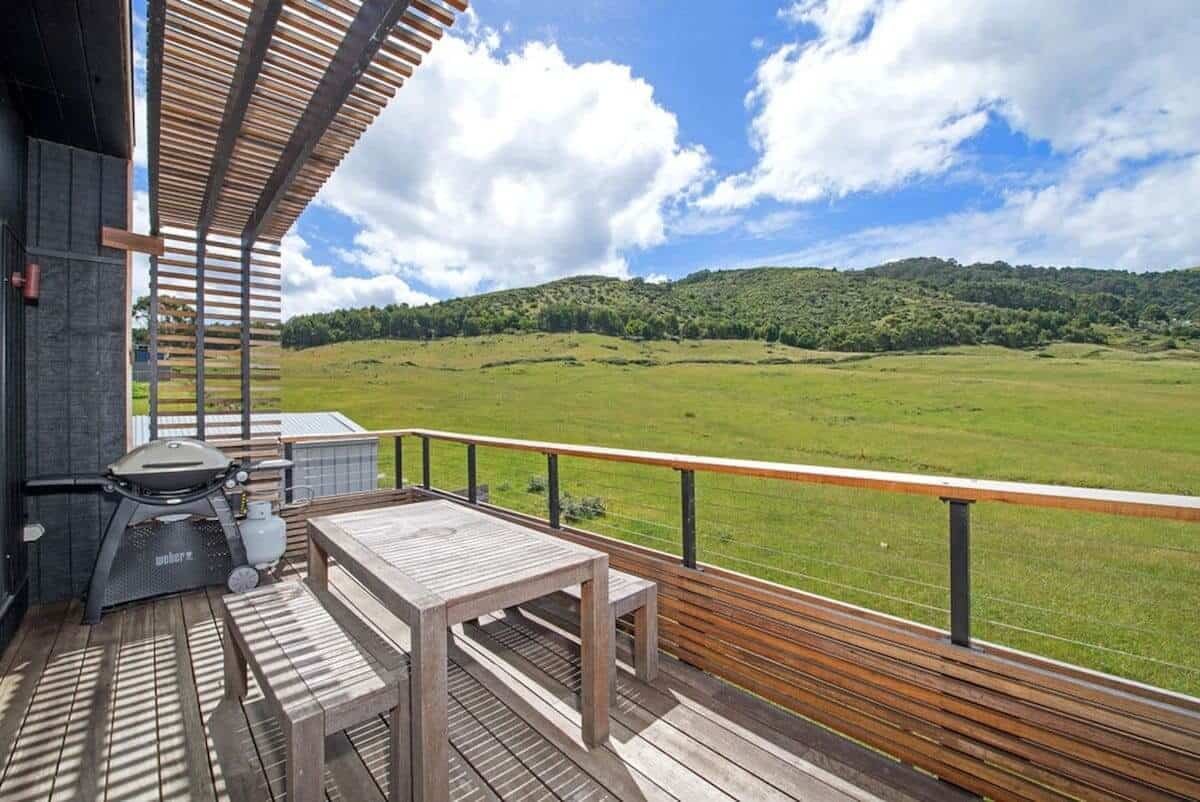 View from the balcony overlooking green fields at Bay Retreat