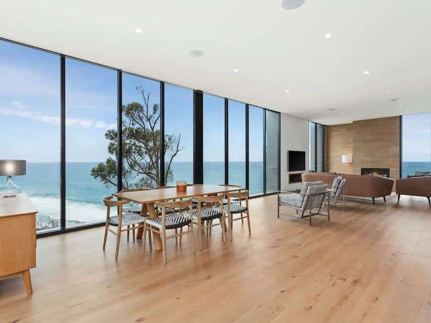 Iluka Blue Apartment with floor to ceiling windows looking out to the ocean, dining table with 6 chairs
